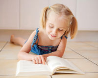 A cute little girl reading Stock Photo