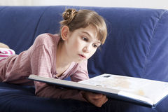 Cute little girl reading book Stock Photography