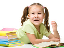 Cute little girl is reading a book Royalty Free Stock Photography