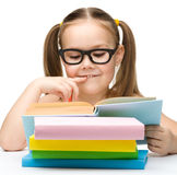 Cute little girl is reading book Royalty Free Stock Photo