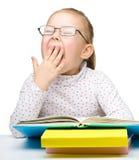 Cute little girl reading book Stock Photos