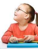 Cute little girl reading book Royalty Free Stock Image