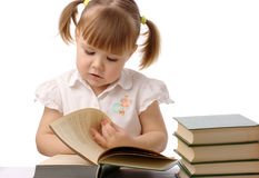 Cute little girl is reading book, back to school Stock Photo