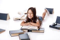 Cute little girl is reading a book. stock photos