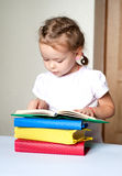 Cute  little girl reading book Royalty Free Stock Photography