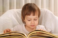 Cute little girl reading a book Royalty Free Stock Photography