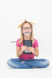 Cute little girl is reading book Stock Photo