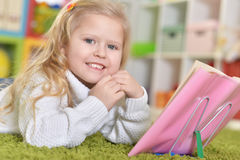 Cute little girl  reading Royalty Free Stock Image
