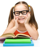 Cute little girl reads a book Royalty Free Stock Photography