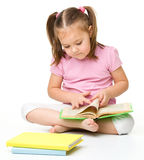 Cute little girl reads a book Royalty Free Stock Image