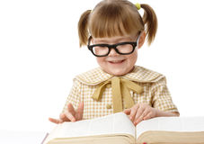 Cute little girl reads book, back to school Royalty Free Stock Photography