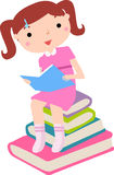 Cute little girl reaing book Royalty Free Stock Images
