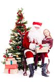Getting gift from Santa Claus stock photo