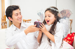 Cute little girl receiving present from dad Royalty Free Stock Photography