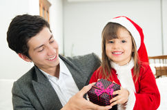 Cute little girl receiving present from dad Royalty Free Stock Photo