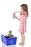 Young girl recycling. Cute little girl recycling a can Royalty Free Stock Images