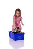 Young girl recycling. Cute little girl recycling a can Royalty Free Stock Photo