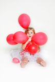 Cute little girl with red balloons Royalty Free Stock Photos