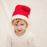 Cute little girl in red christmas hat Stock Photo
