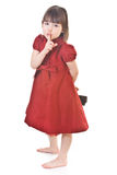 Cute little girl in a red dress Royalty Free Stock Image