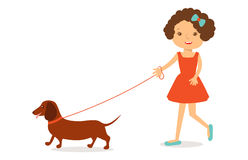 Cute little girl in red dress with curly hair  dachshund dog. Royalty Free Stock Images