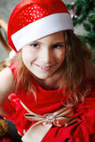 Cute little girl in a red dress Royalty Free Stock Photo
