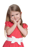 Cute little girl in the red dress Stock Photo