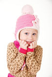 Cute little girl in red hat holding hands to face in surprise Stock Image