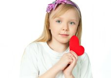 Cute little girl with red heart Stock Photography
