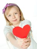 Cute little girl with red heart Royalty Free Stock Photo