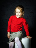 Cute little girl in red jacket Stock Photo