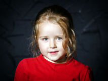 Cute little girl in red jacket Royalty Free Stock Photos
