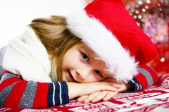 Cute little girl in red santa hat christmas portrait Stock Photography