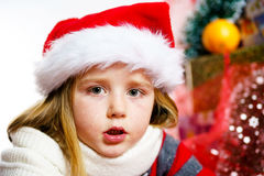 Cute little girl in red santa hat christmas portrait Royalty Free Stock Photos