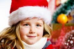 Cute little girl in red santa hat christmas portrait Stock Photo