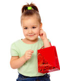 Cute little girl with red shopping bag Royalty Free Stock Photo
