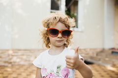 Cute little girl in red sunglasses Stock Photo