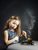 Cute little girl repair electronics by cooper-bit stock image
