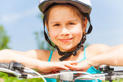 Cute little girl rest on a bicycle Stock Images