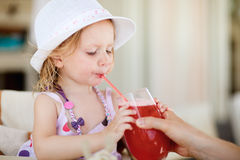 Cute little girl in restaurant Stock Photography