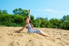 Cute little girl resting on beach Stock Photos