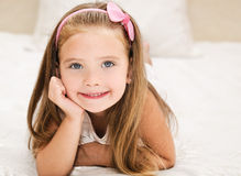 Cute little girl resting on the bed Stock Photos