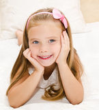 Cute little girl resting on the bed Stock Image