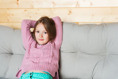 Cute little girl resting on a terrace Royalty Free Stock Photography