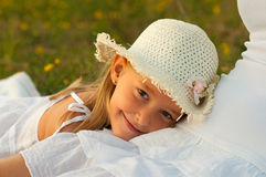 Cute little girl rests her head in her mothers lap Stock Photography