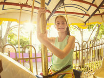 Cute little girl riding on a Carnival Carousel Stock Images