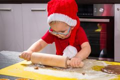 Girl with roller pin preparing Christmas cookies. Cute little girl with roller pin preparing Christmas cookies Royalty Free Stock Photos