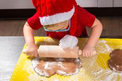 Girl with roller pin preparing Christmas cookies Stock Photography