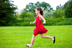 Cute little girl running Stock Photos