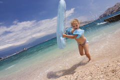 Cute Little Girl Running At The Beach Stock Image